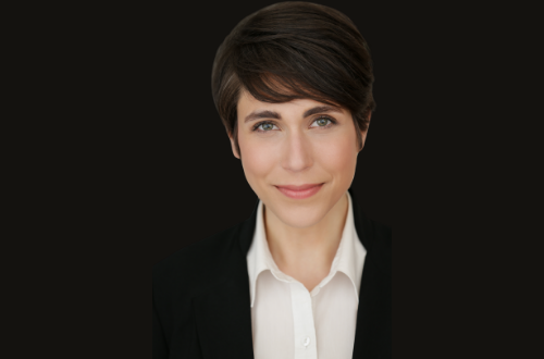 Ari Scheller against a black background. Professional picture taken while she worked as a product manager.